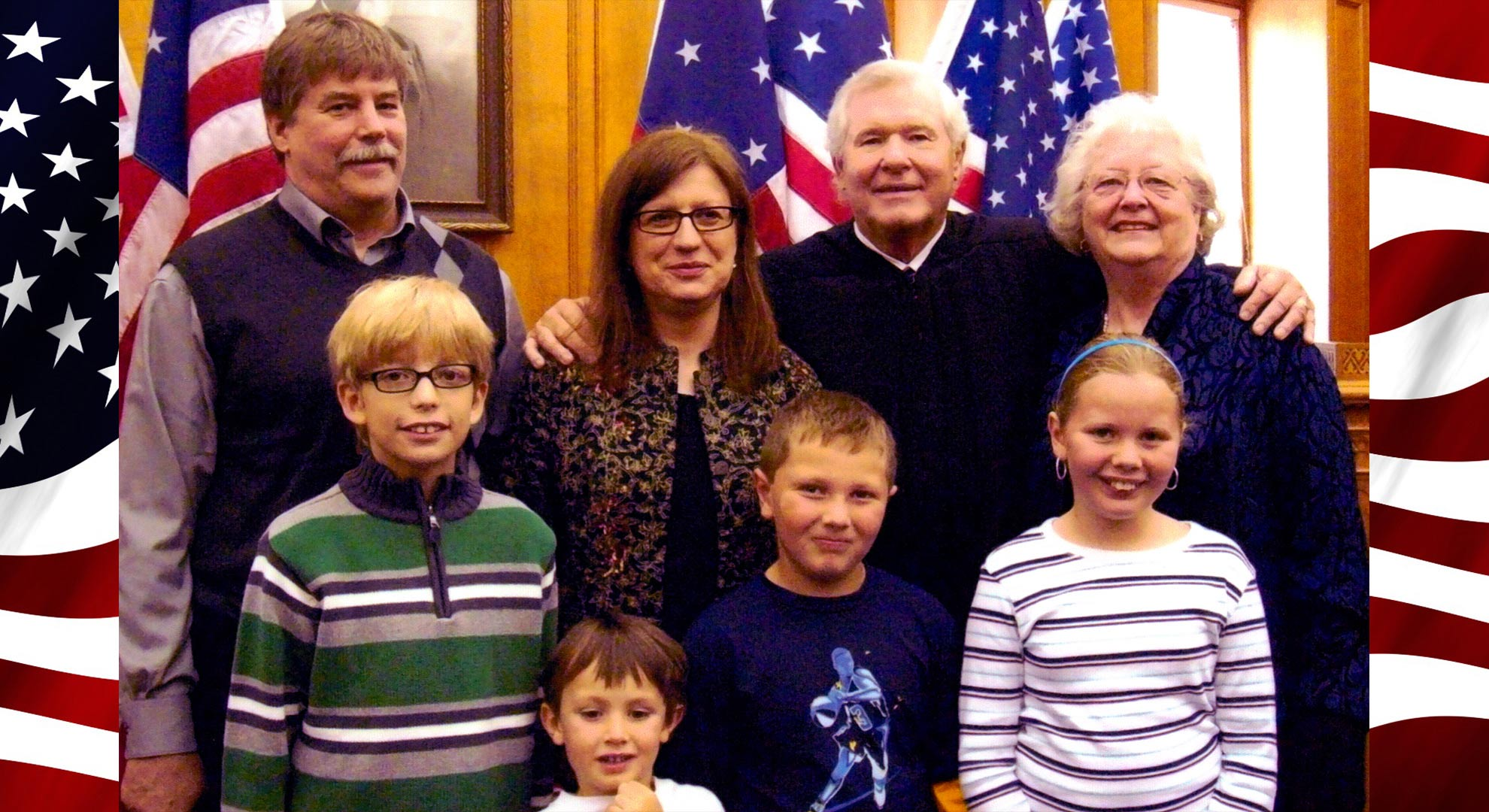 Maria, family and friends with the Judge that presided over her U.S. Citizenship Naturalization.
